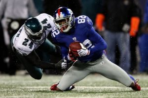 Sheldon Brown #24  i Mario Manningham #82 w meczu Eagles z Giants